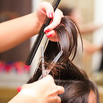 hairdresser do haircut close up indoor s
