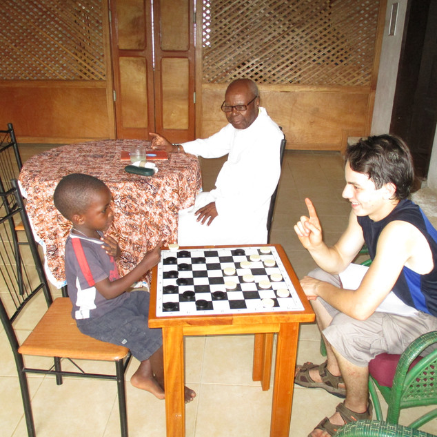 Teaching Marc Antwon how to play checkers. He had never played before and I explained how you can only move one piece at at time. He figured it out pretty quick and became a checkers shark in no time.