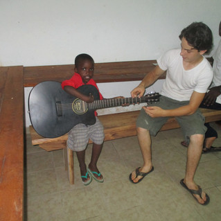 Marc Antwon doing his best to play guitar. It was a little too big for him.