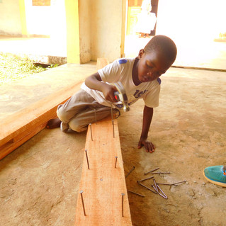 This is Marc Antwon, at the time he was 6 and was insistant on helping us build the roof frames. He's adorable!
