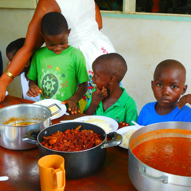 Hot meals of chicken, beans, and rice are a typical sight at the mission.