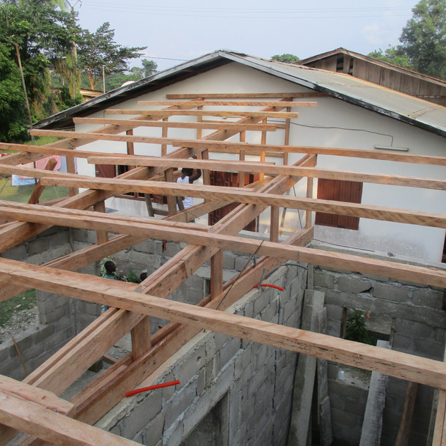 This was really my first experience with roofing. We first used some of the local wood to build the frames and then we build metal tin roofs. This particular roof was for the local charity that baked bread a stone throw away from us.