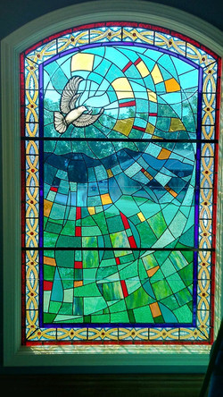 Stained glass window in master bath