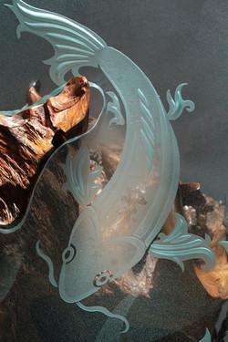 Koi sandblasted glass on drift wood