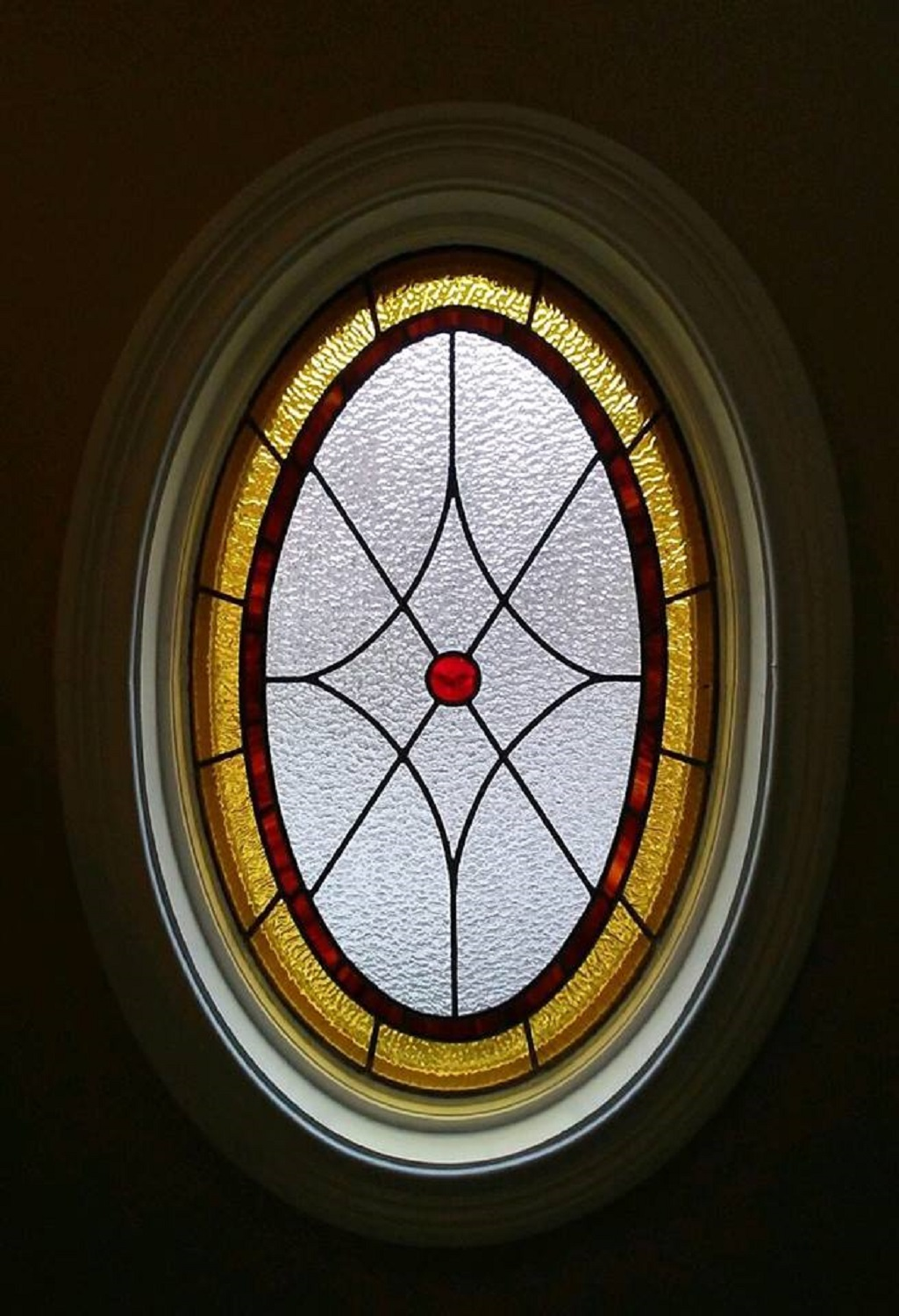 Stained glass oval in master bath
