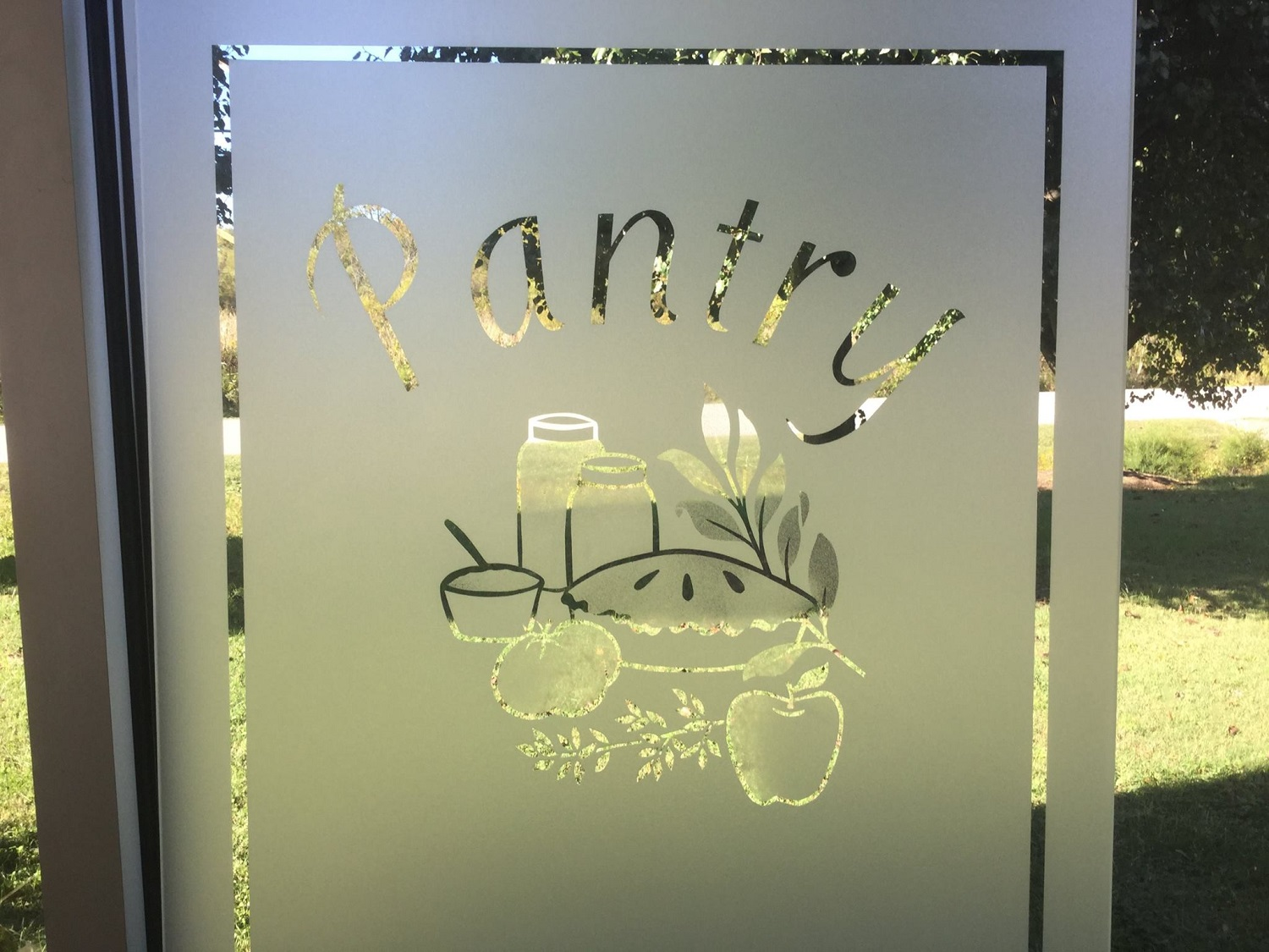 Sandblasted glass pantry door