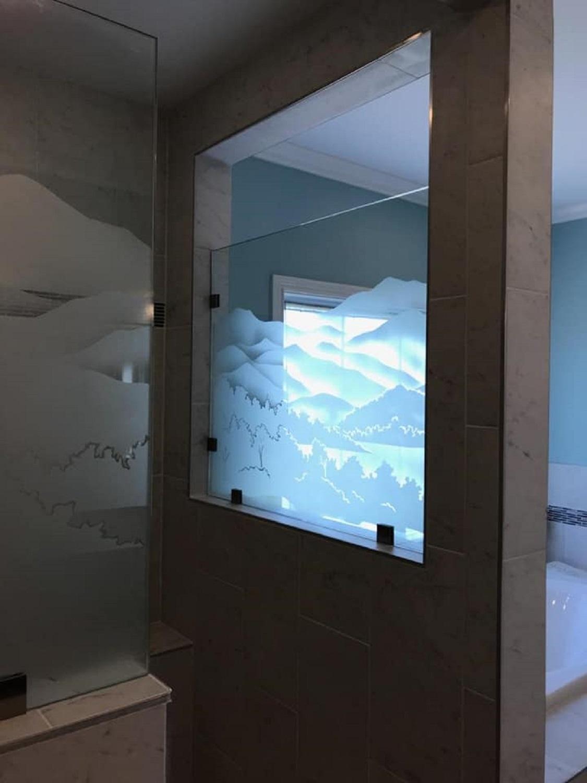 Sandblasted glass shower enclosure