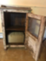 gray cabinet with door open.jpg