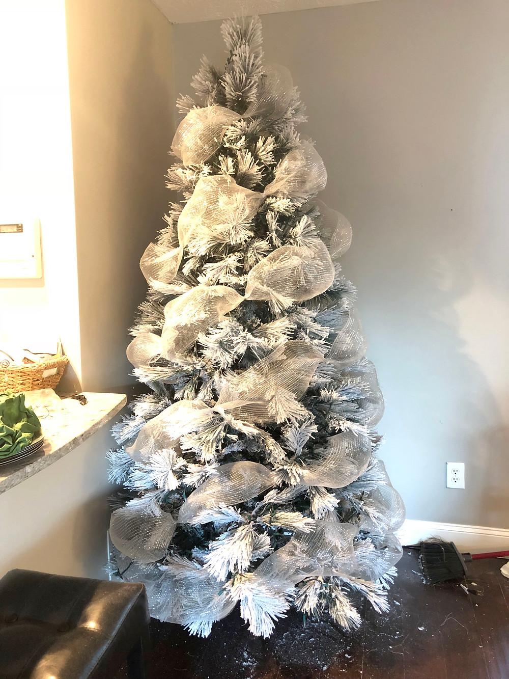 Silver deco mesh on white christmas tree