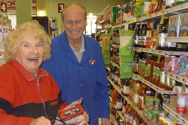 Cash Market owner, James Mancini, with happy customer