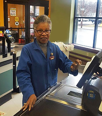 Smiling Cash Market Cashier at checkout station