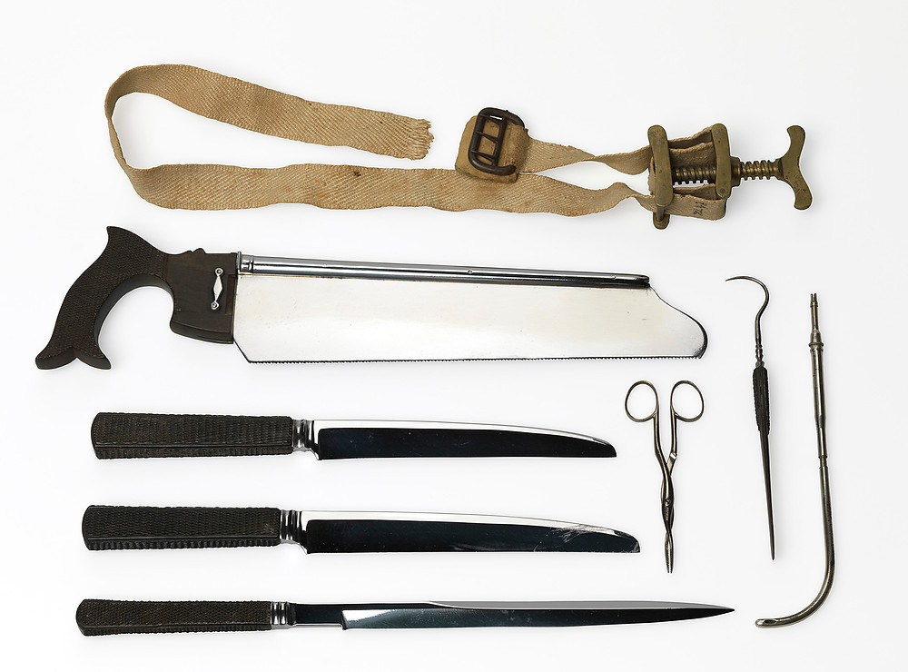 Tools of the trade. From the top: a petit tourniquet, bone saw, two amputation knives, and a catlin. Aside: two dressing forceps, a tenaculum, and a catheter. (Records of the American National Red Cross)