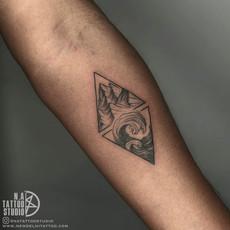custom mountain sea wave tattoo.jpg