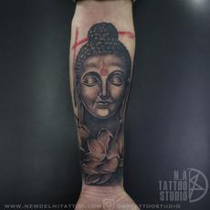 buddha lotus tattoo.jpg