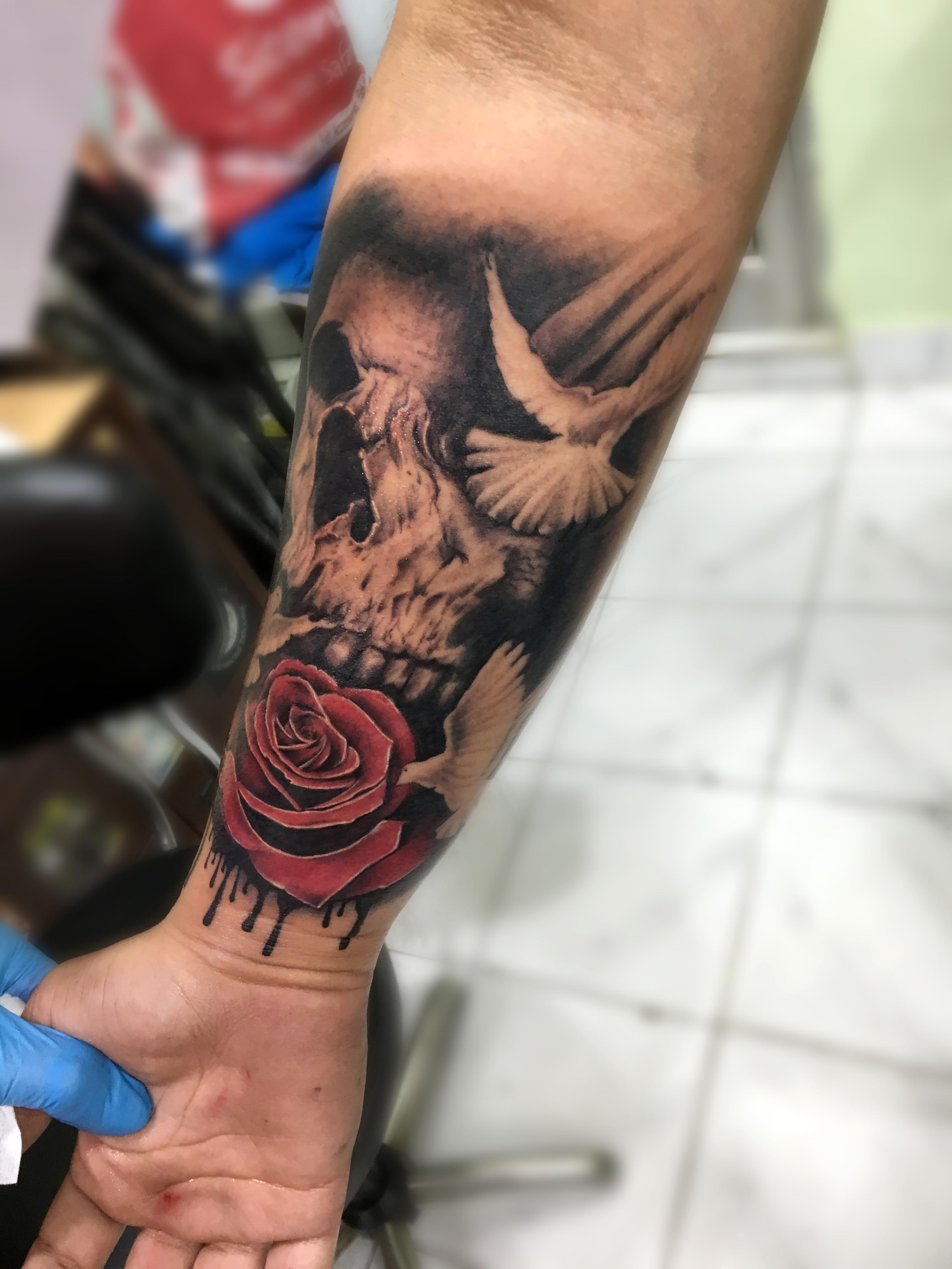 Skull with Roses and bird