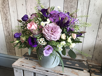 Flower Arrangement in a Container.png