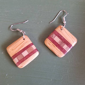 Earrings made from floor board of a demolished local house