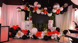 Black, white and red balloon arrangement covering event venue