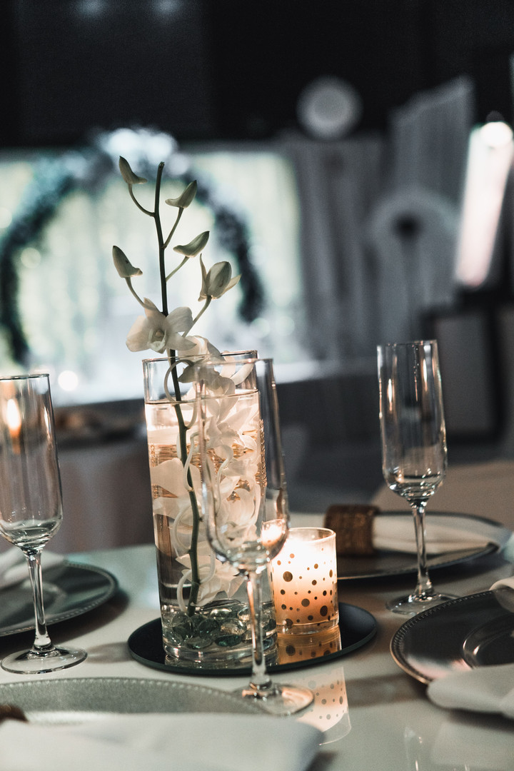 Table centerpiece with candles in a banquet hall