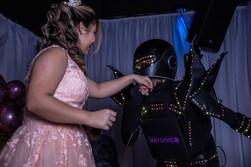 led robot kissing birthday girl hand