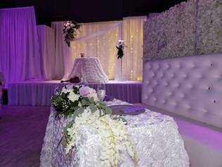 stage decorated for pink wedding in miami