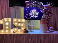 stage decorated with balloon arch in party hall