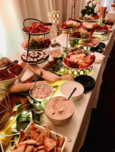 Grazing table full of sweet and salty appetizers