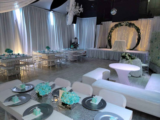 wedding venue with stage decorated with flowers