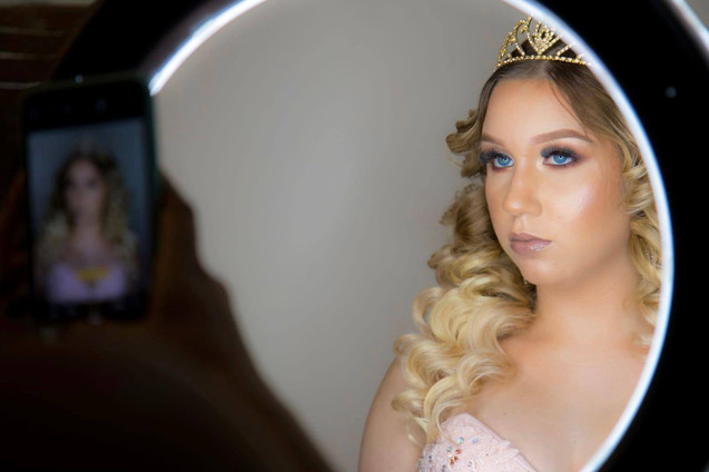 Woman dressed as princess looking at herself in a mirror