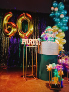 60th birthday cake and balloons
