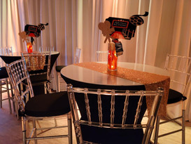 black, red and gold decoration in party venue in Kendall Miami with orange centerpiec