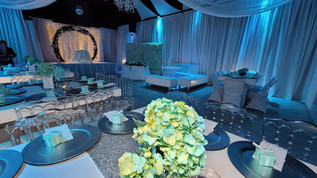 banquet hall decorated with blue lights for wedding