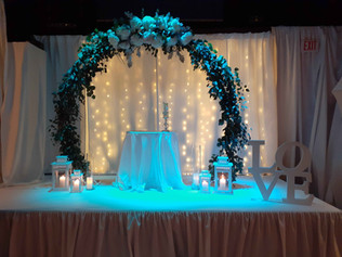 Stage with a circular flower arrangement