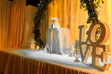 Golden decoration and love sign in wedding venue in Kendall Miami