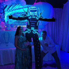 led robot with couple at baby shower in miami