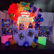 stage decorated for thematic party of superheroes