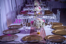 golden plates on table at banquet hall