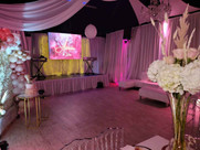 party venue decorated with pink lights and fabrics