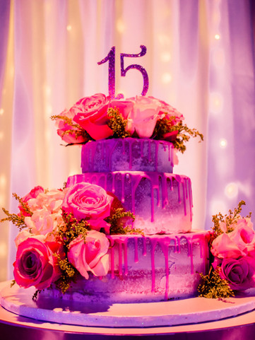3-layer cake decorated with pink flowers