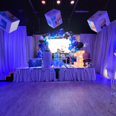 stage decorated with balloons for kids themed party