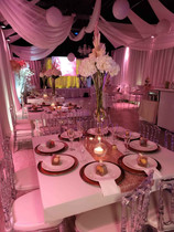 pink decorated tables in banquet hall in miami