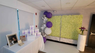 decorated wall and balloons for baby shower