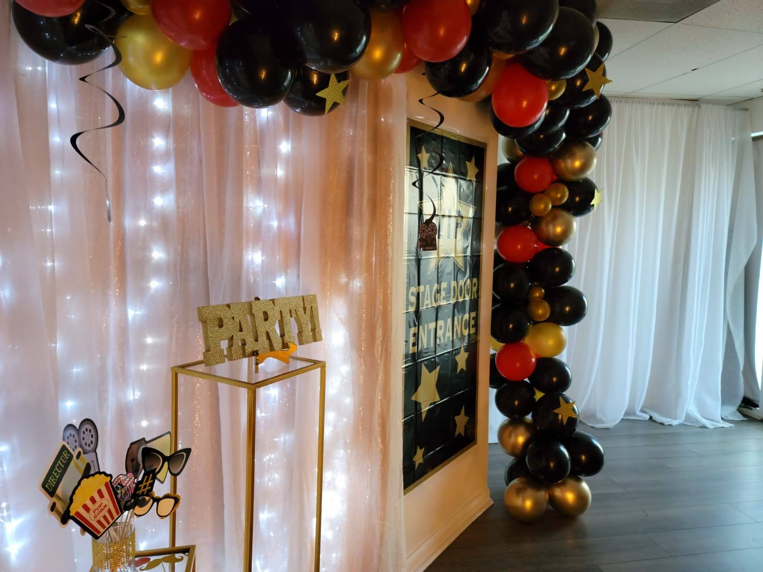 Black, red and gold balloons party decoration in venue
