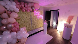 decoration with pink balloon arch in sweet 16