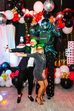 birthday boy with led robot at party venue