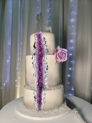 3 tier cake topped with rose for wedding