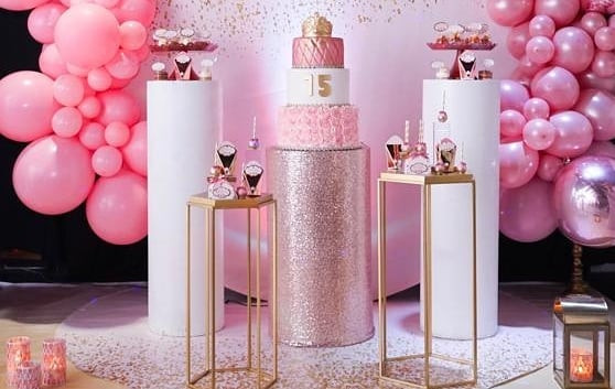 pink decoration with balloon arrangement and cake 15th birthday party