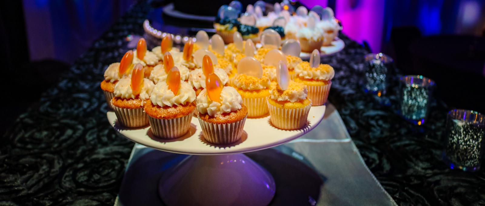 A lot of yellow cupcakes on a round white plate