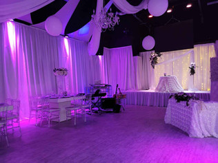 banquet hall with fuchsia lights for wedding