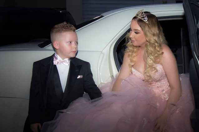 A boy and a girl getting out of a car